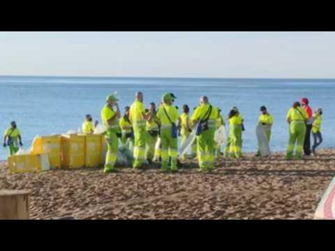 Cleaning the Barceloneta beach after San Juan's Night