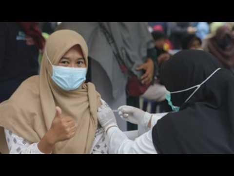Indonesia accelerates vaccination drive amid new COVID-19 surge