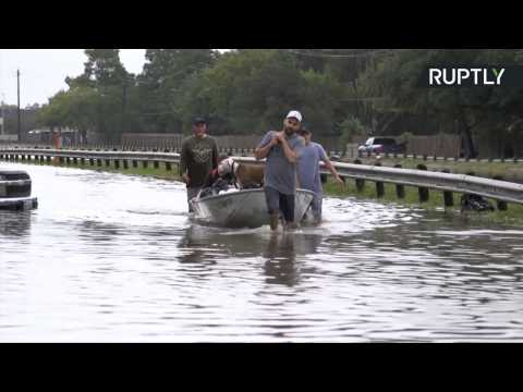 Volunteer Rescuers Use Boats to Save Stranded People in Flooded Houston