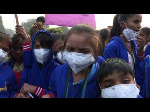 Dozens of New Delhi children take part in anti-smog protest