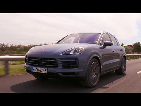 The new Porsche Cayenne E-Hybrid in Moonlight Blue Metallic Driving Video