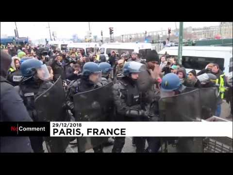 Yellow vest demonstrators clash with police in Paris