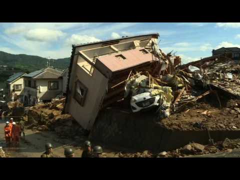 Toll in record Japan rains hits 100