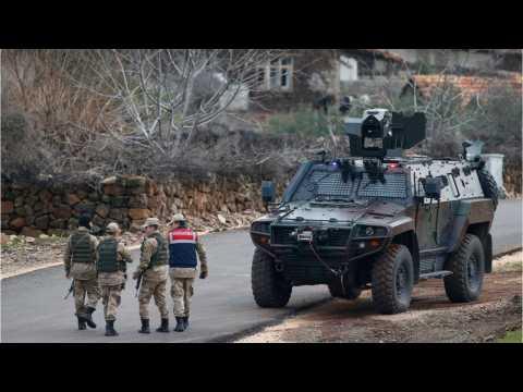 Turkish Forces Push Into Syria, Clash With Kurdish Militia