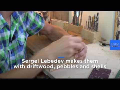 Watch: Artist creates cameras made of wood
