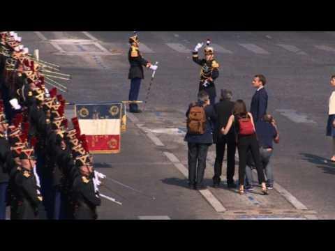 Emmanuel Macron arrives at the Champs Elysees for Bastille Day
