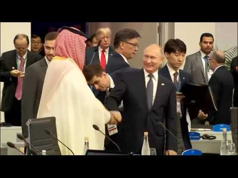 Watch: Putin and Saudi crown prince laugh and clap hands at G20 summit