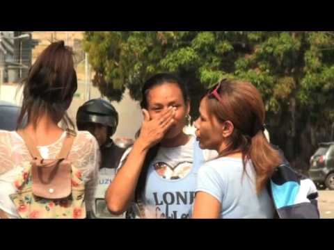 Relatives of 68 killed await answers after Venezuelan blaze