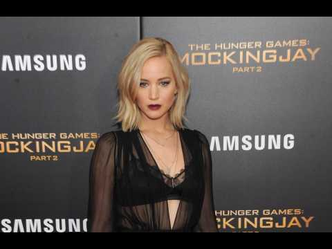 Jennifer Lawrence insists it was her decision not to cover up her revealing Versace dress