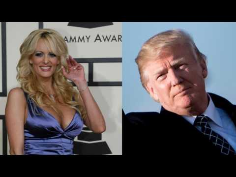Porn actress says threatened to keep silent on Trump fling