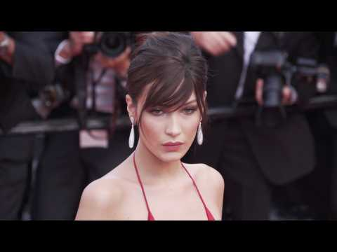 Bella Hadid trips in high heels and finds it hilarious