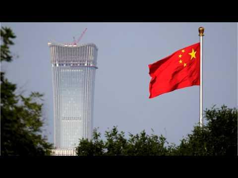 Asian Shares Sag On New U.S. Tariff Threat