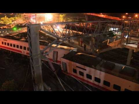 Rescue workers on site of a deadly train crash in Taiwan