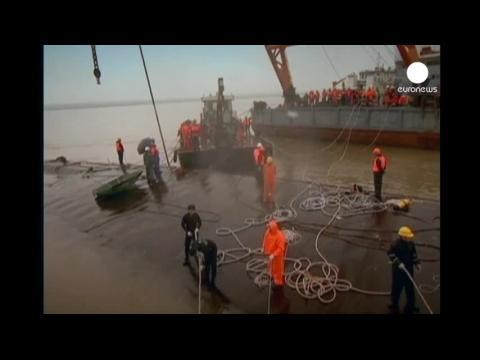 China ship disaster: 65 confirmed dead, hundreds still missing