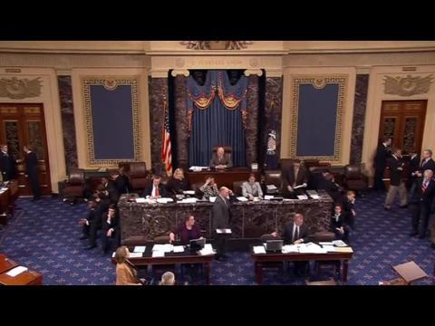 Bitter partisanship before U.S. Senate passes major spending bill