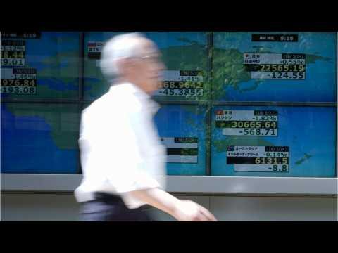Asian Shares Up Despite Negative Economic Outlook