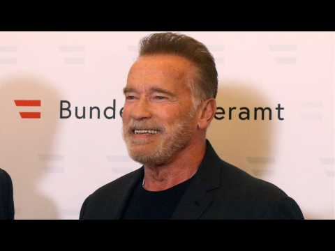 Arnold Schwarzenegger Aids Young Wrestler In Fight