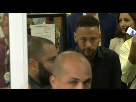 Neymar leaves a police station in Rio de Janeiro