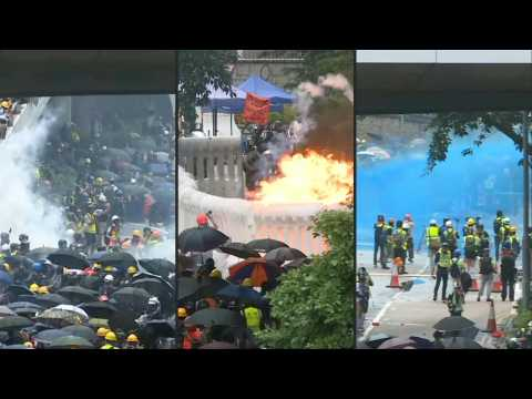 Tear gas and water cannon as Hong Kong police clash with protesters