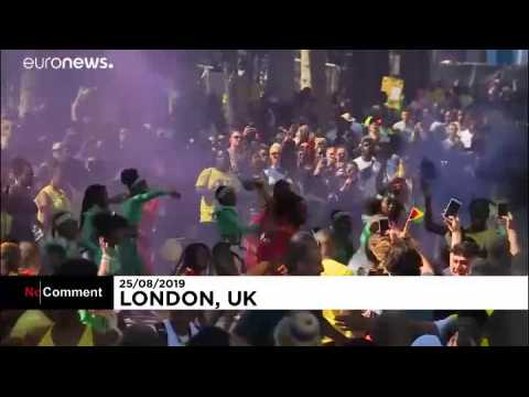 Revellers enjoy sunshine at hot Notting Hill Carnival
