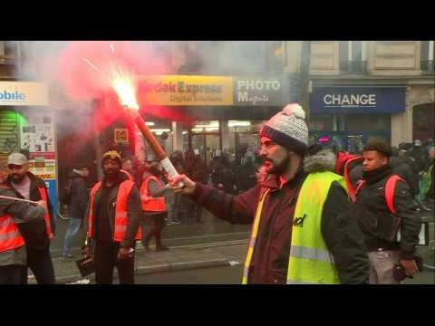 Protesters against pension reform take to Paris streets (2)