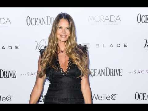 Elle Macpherson hits back at troll over cosmetic surgery claims
