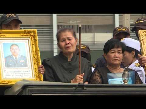 Families claim their dead as Thais mourn 29 killed in mass shooting