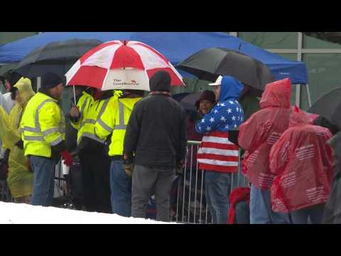 Supporters line up in the rain ahead of Trump's rally in New Hampshire