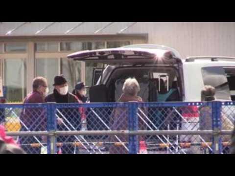 Passengers begin disembarking quarantined cruise ship in Yokohama