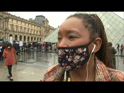 Tourists react as Paris's Louvre museum remains shut over coronavirus fears