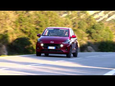 The new Hyundai i10 in Dragon Red Driving in the country