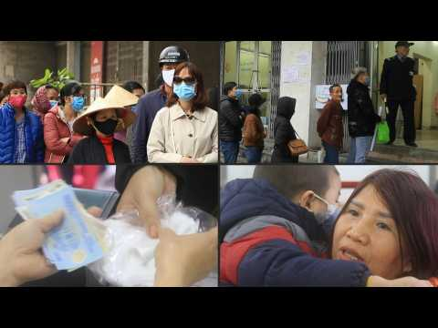 Vietnamese line up to buy face masks amid virus concern