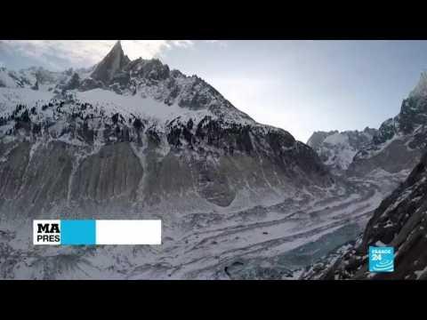 "Macron urges ""fight of the century"" during shrinking glacier visit"