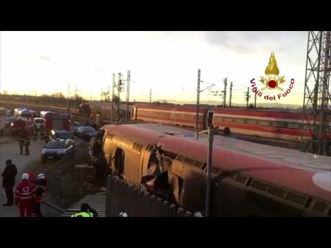 Rescue teams on site of derailed train in Italy
