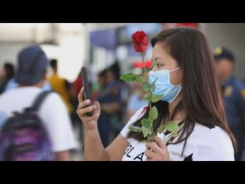 Police in Manila celebrate Valentine's Day with live performances