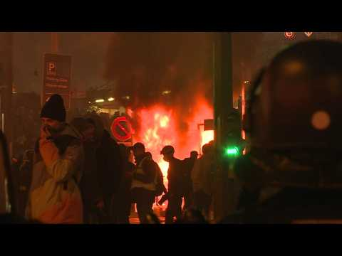 Fires, tear gas and arrests after yellow vest protest in Paris