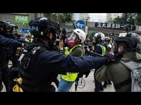 Rally cut short in Hong Kong as police confront protesters