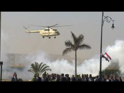Helicopter carrying the body of Mubarak arrives ahead of his funeral in Cairo