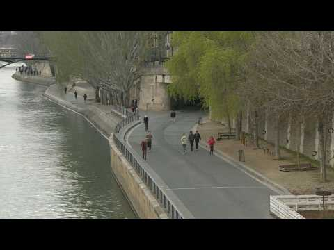 Banks of Seine deserted in Paris on first day of new lockdown
