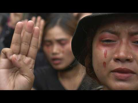 Myanmar anti-coup protesters don red 'blood' tears