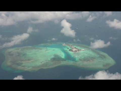 Philippines patrol images show Chinese ships around disputed Spratly Islands