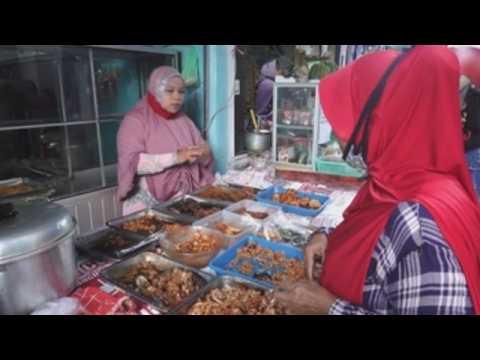 Vendors in Bali serve customers iftar food during Ramadan