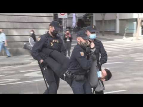 Police disperse activists during climate protest in Madrid