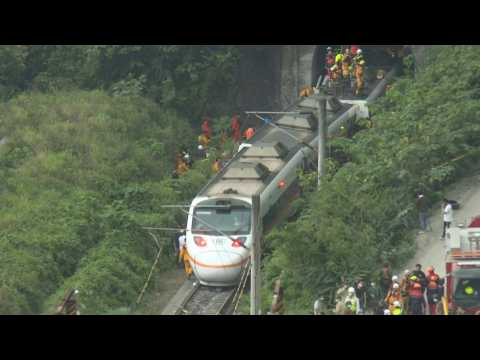 Images of Taiwan train crash site and rescue workers