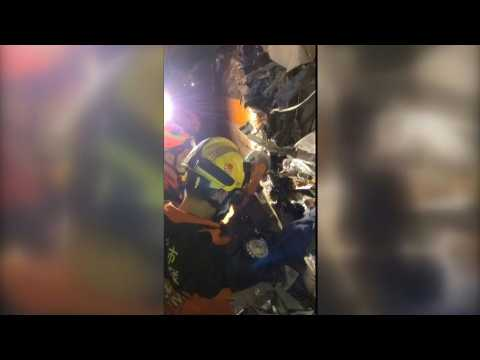 Rescuers work to free people trapped in derailed Taiwan train