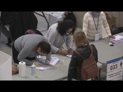 Ecuadorian citizens living in Spain vote in their country's election