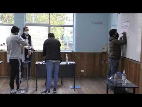 Vote count starts as polls close in Ecuador presidential runoff