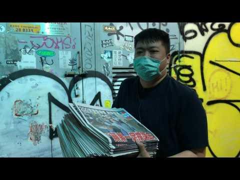 Defying China, Hong Kongers rush to buy pro-democracy newspaper