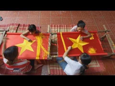 Vietnamese village famous for embroidery makes national flags ahead of Independence day