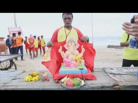 Hindus celebrate last day of festival for god Ganesha with water rituals